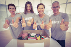Smiling volunteers doing thumbs up Royalty Free Stock Photos