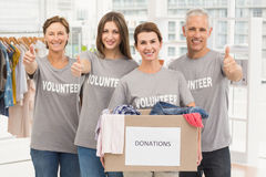 Smiling volunteers with donation box Royalty Free Stock Photo