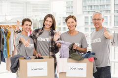 Smiling volunteers with donation boxes Stock Photo
