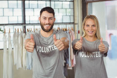 Smiling volunteers giving thumbs up Royalty Free Stock Photography