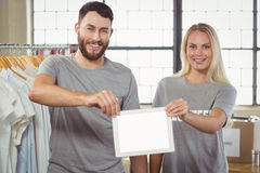 Smiling volunteers holding digital tablet Royalty Free Stock Photography