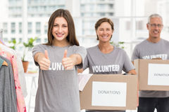 Smiling volunteers holding donation boxes Royalty Free Stock Photo