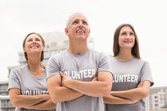 Smiling volunteers looking up Stock Images