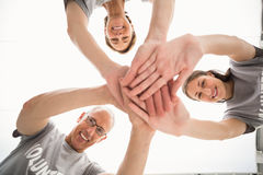 Smiling volunteers putting hands together Royalty Free Stock Photography