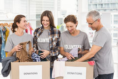 Smiling volunteers sorting donation boxes Stock Image