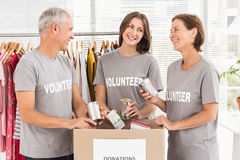 Smiling volunteers sorting donations Stock Photos