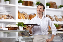 The smiling waiter Royalty Free Stock Photos