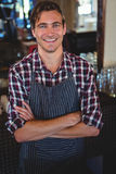 Smiling waiter with arms crossed Royalty Free Stock Images