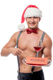 Smiling waiter with a glass of red wine Royalty Free Stock Image