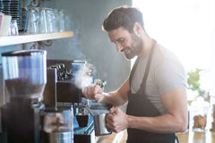 Smiling waiter making cup of coffee stock photos