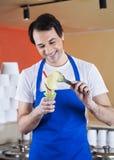 Smiling Waiter Preparing Vanilla Ice Cream Stock Photos