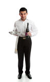 Smiling waiter or servant with wine and glasses Royalty Free Stock Images
