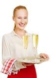 Smiling waiter serving champagne Stock Image