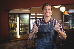 Smiling waiter with thumbs up royalty free stock photography