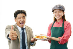 Smiling waitress and a customer Royalty Free Stock Photos