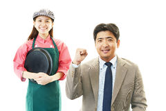 Smiling waitress and a customer Stock Images
