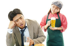 Smiling waitress and a drunk customer Stock Image