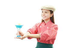 Smiling waitress with a glass of cacktail Stock Images