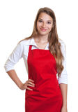 Smiling waitress with red apron Royalty Free Stock Image