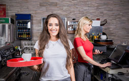 Smiling waitress Stock Photos
