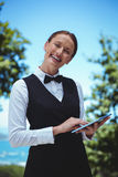 Smiling waitress taking an order with a tablet Stock Photography