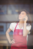 Smiling waitress talking on the phone Stock Photos