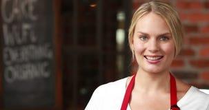 Smiling waitress winking at the camera stock video