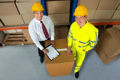 Smiling Warehouse Manager Checking Inventory Stock Photo