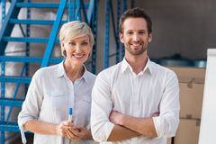 Smiling warehouse managers looking at camera Royalty Free Stock Images