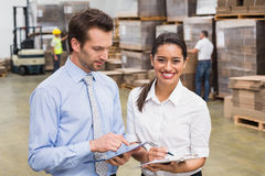 Smiling warehouse managers working together Stock Photos