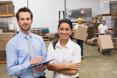 Smiling warehouse managers working together Royalty Free Stock Photography