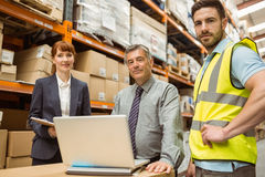 Smiling warehouse team looking at camera Royalty Free Stock Images