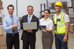 Smiling warehouse team working together Royalty Free Stock Photography