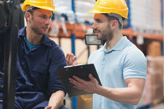 Smiling warehouse workers talking together Royalty Free Stock Photo