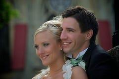 Smiling wedding couple stock images