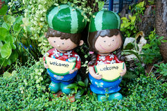 Smiling welcome boy and girl clay dolls Stock Images
