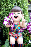 Smiling welcome girl clay doll Stock Images