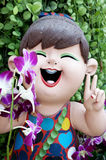 Smiling welcome girl clay doll Stock Photo