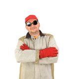 Smiling welder in glasses crosses arms. Royalty Free Stock Photo