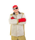 Smiling welder in glasses crosses arms. Royalty Free Stock Photography