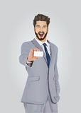 Smiling well dressed businessman showing business card Royalty Free Stock Photo