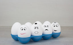 Smiling white row eggs. Smiling white eggs in one row Royalty Free Stock Photography
