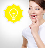 Smiling white woman with electric lamp Stock Photography