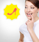 Smiling white woman thinking about shopping Stock Images