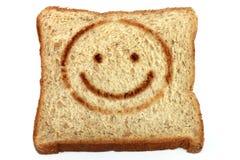 Smiling whole wheat bread Stock Photos