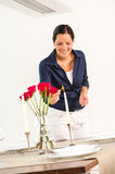 Smiling wife lighting candle romance flowers love stock images