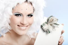 Smiling winter beauty with christmas present Stock Photography