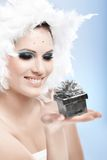 Smiling winter beauty with little present box Royalty Free Stock Photography