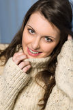 Smiling winter brunette woman in beige sweater Royalty Free Stock Images