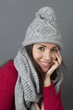 Smiling winter girl expressing wellbeing and temperature comfort Stock Images